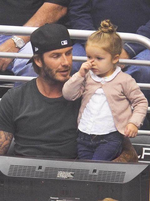 <p>David and Harper Beckham</p>