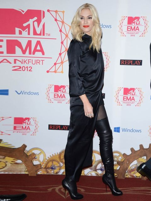 <p>Gwen Stefani arrived at the event in a black silk dress and leather over-the-knee boots</p>