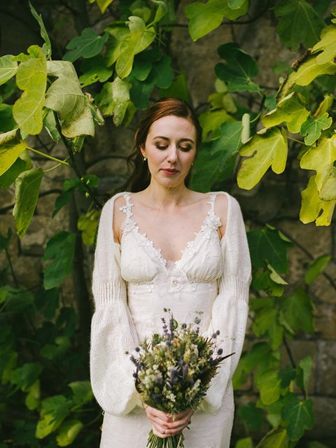 "<p>My wedding dress was the 'Constance' by <a href=""http://www.clairepettibone.com/"" target=""_blank"">Claire Pettibone</a>. As soon as I started looking for dresses, I was immediately drawn to her boho and nature-inspired designs.</p>