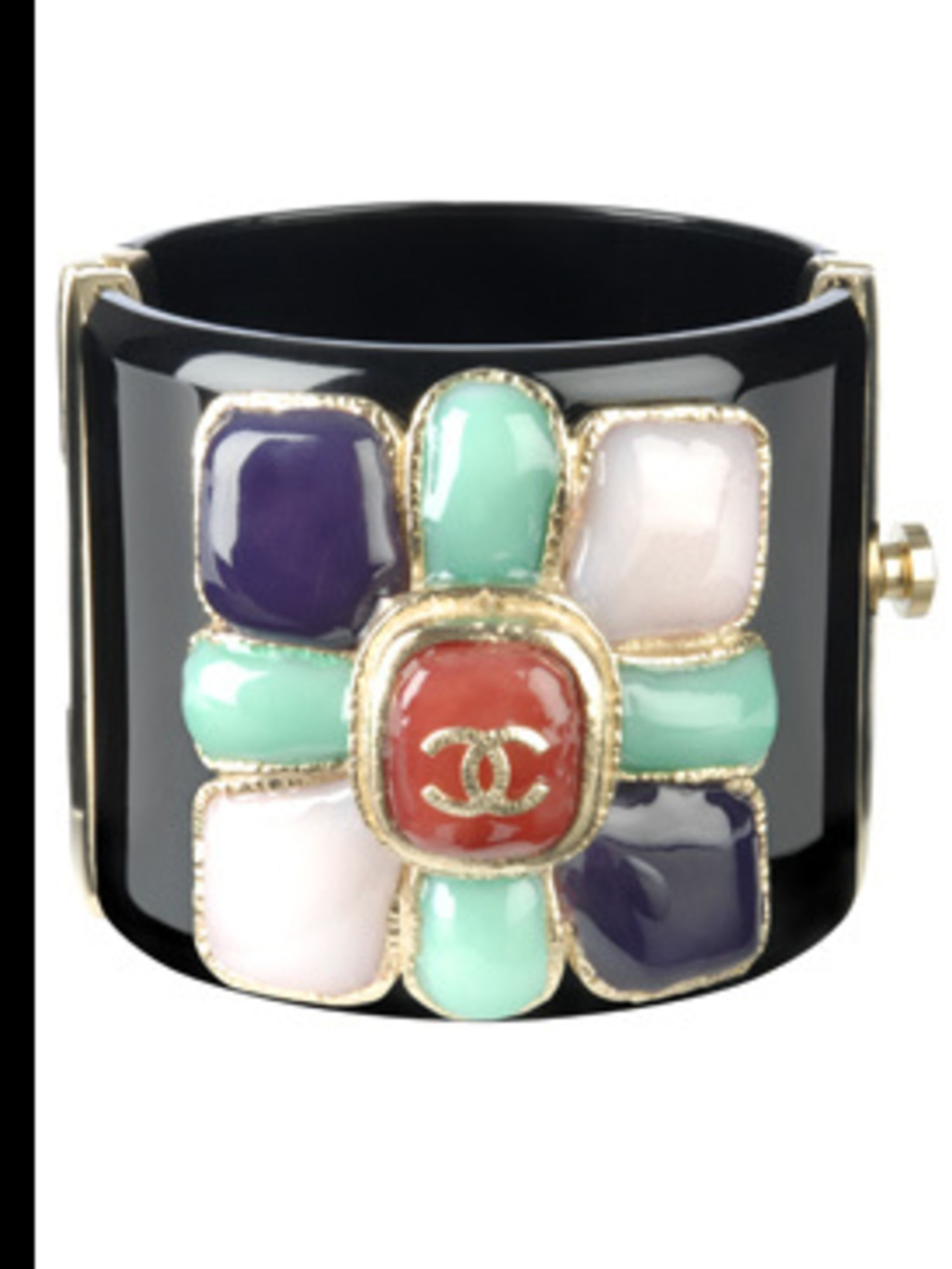 <p>Jewelled cuff £632 by Chanel, for stockists call 0207 493 5040</p>