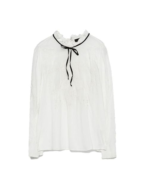 "<p><a href=""http://www.zara.com/uk/en/collection-ss15/woman/shirts/tie-neck-embroidered-blouse-c358004p2409043.html"" target=""_blank"">Zara</a> white shirt, £29.99</p>"