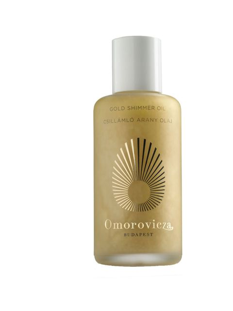 """<p><a href=""""http://www.omorovicza.com/uk/product-use/natural-body-skincare/gold-shimmer-oil.html"""">Omorovicza</a> Gold Shimmer Oil, £52</p>"""