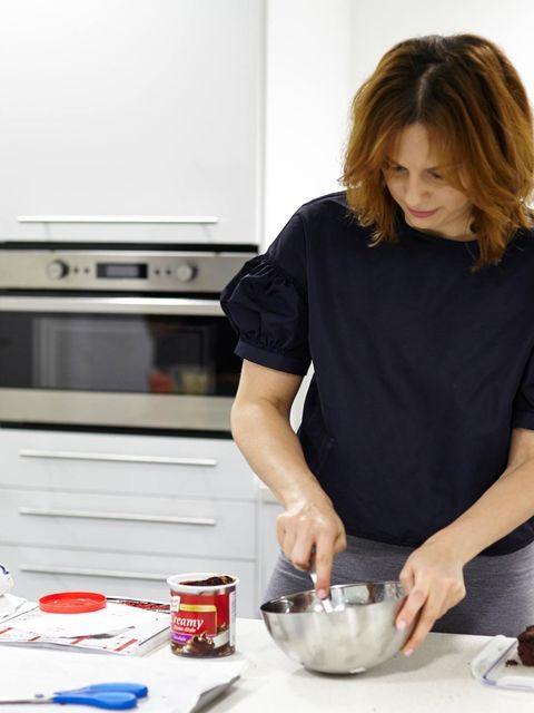 <p>Beauty Director Sophie Beresiner preparing Halloween cake pops in ELLE's Ikea kitchen.</p>