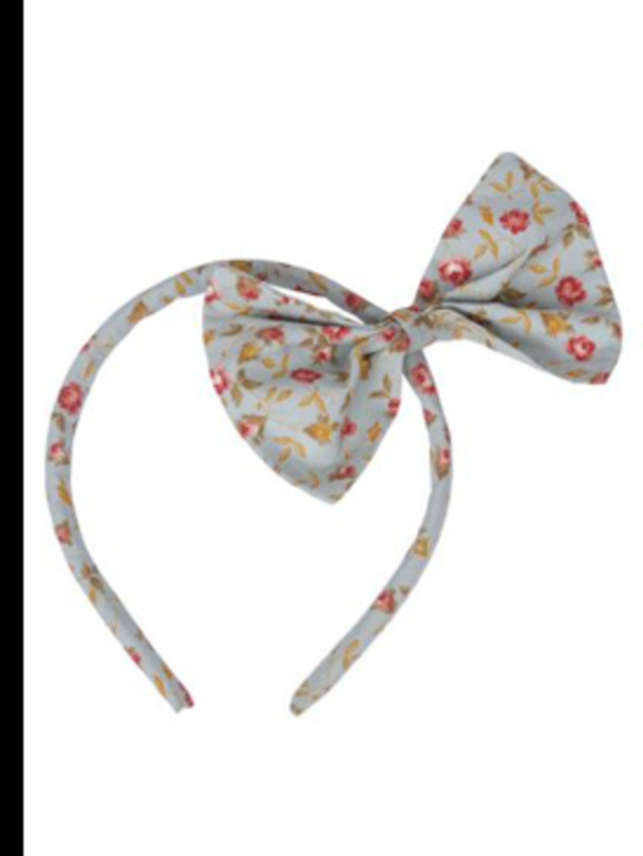 "<p>Bow headband, £12, by Miss Crofton at <a href=""http://www.pretaportobello.com/Onlineproductdetail.aspx?PId=fe85dcb9-d321-426e-9687-ba6a73535eb9"">www.pretaportobello.com</a></p>"