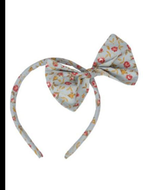 "<p>Bow headband, £12, by Miss Crofton at <a href=""http://www.pretaportobello.com/Onlineproductdetail.aspx?PId=fe85dcb9-d321-426e-9687-ba6a73535eb9"">www.pretaportobello.com</a></p>"