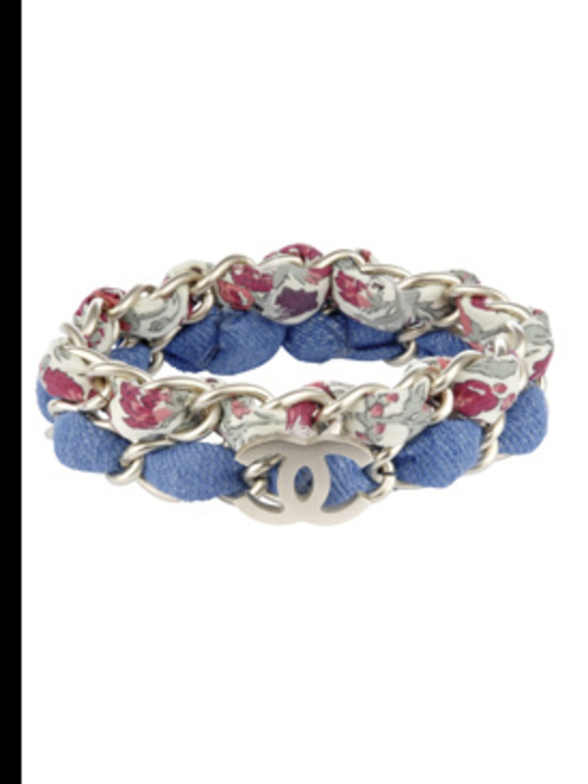 <p>Floral chain bracelet, £360, by Chanel. For stockists call 020 7493 5040 </p>