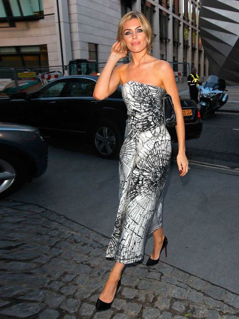 "<p>Abbey Clancy wears Giles dress and Christian Louboutin Pigalle pumps to <a href=""http://www.elleuk.com/catwalk/designer-a-z/giles/spring-summer-2014"">Giles SS14</a> show at London Fashion Week.</p>"