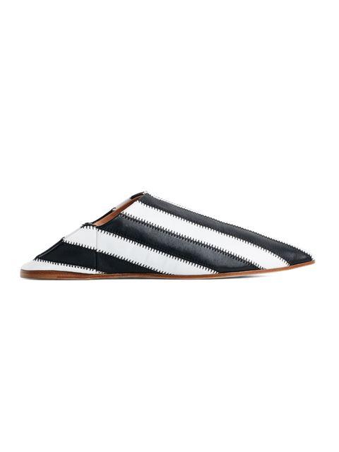 """<p><a href=""""http://www.acnestudios.com/uk/en/shop/women/shoes/amina-patch-white-black.html"""" target=""""_blank"""">Acne Studios</a>babouche shoes, £430</p>"""