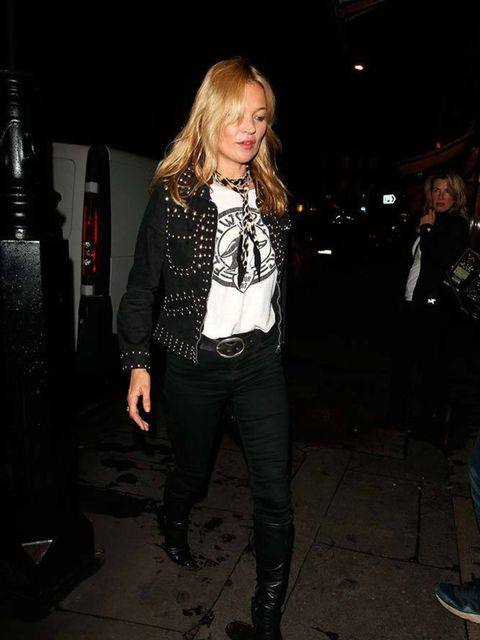 <p>Kate Moss adds a skinny neck scark for the ultimate 'I'm with the band' look.</p>