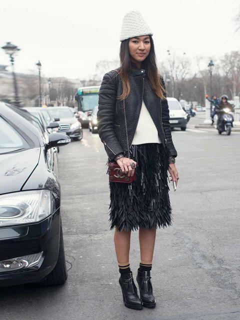 <p>Meruyert Ibragim wears Celine sweater and jacket, Tak Ori hat, Chanel bag, Prada boots and skirt.</p>