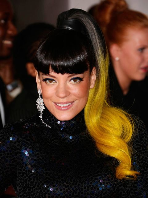 "<p>Lily Allen opted for the same high ponytail as she wore at the <a href=""http://www.elleuk.com/elle-style-awards/red-carpet/elle-style-awards-2014-red-carpet-celebrities-and-designers"">ELLE Style Awards</a> this week, only at the BRIT Awards she added c"