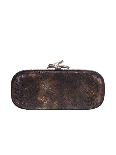 "<p>Diane von Furstenburg snake embossed clutch, £230, at <a href=""http://www.farfetch.com/shopping/women/diane-von-furstenberg/bags-purses/item10075961.aspx"">farfetch.com</a></p>"
