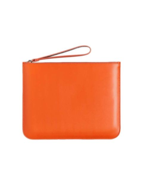 "<p>Acting Deputy Chief Sub-Editor Charlotte Cox will add a pop of colour to her everyday style with this sleek clutch.</p><p><a href=""http://www.stories.com/gb/Bags/All_bags/Leather_pouch/590765-736313.1"">& Other Stories</a> clutch, £29</p>"