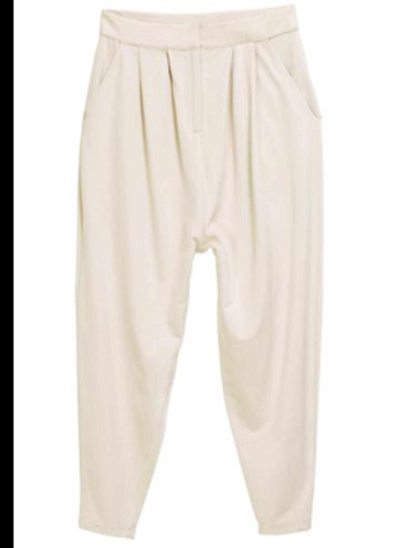 <p>Cream harem pants, £19.99, by H&M (0207 323 2211)</p>