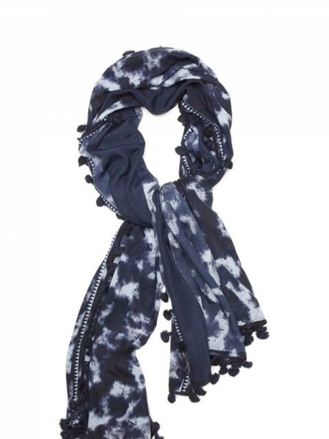 <p>Tie dye pom pom scarf, £45, by Banana Republic (0207 758 3550)</p>