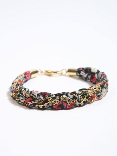 """<p>Floral plait bracelet, £10, by <a href=""""http://www.urbanoutfitters.co.uk/Floral-Plait-Wrap-Bracelet/invt/5764406396283"""">Urban Outfitters</a></p>"""