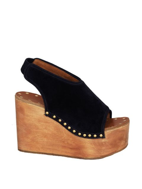 <p>Wedge peep-toe clogs, £560, by Celine at Selfridges (0800 123 400) </p>