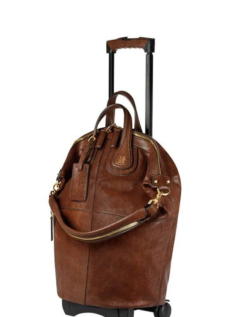 <p>Portable leather holdall, £1,899, by Givenchy at Selfridges (0800 123 400) </p>