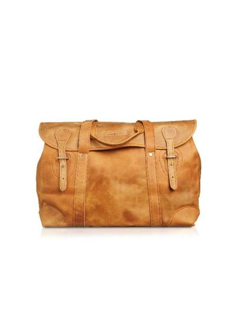 """<p>Tan leather weekend bag, £245, by <a href=""""http://www.sandstormkenya.com/index.php?main_page=index&cPath=1&"""">Sandstorm </a></p>"""