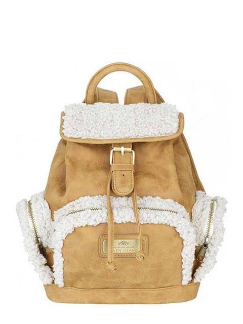 "<p><a href=""http://www.riverisland.com/Online/women/bags--purses/handbags--clutch-bags/brown-sheepskin-rucksack-593481"">River Island</a> sheepskin rucksack, £34.99</p>"