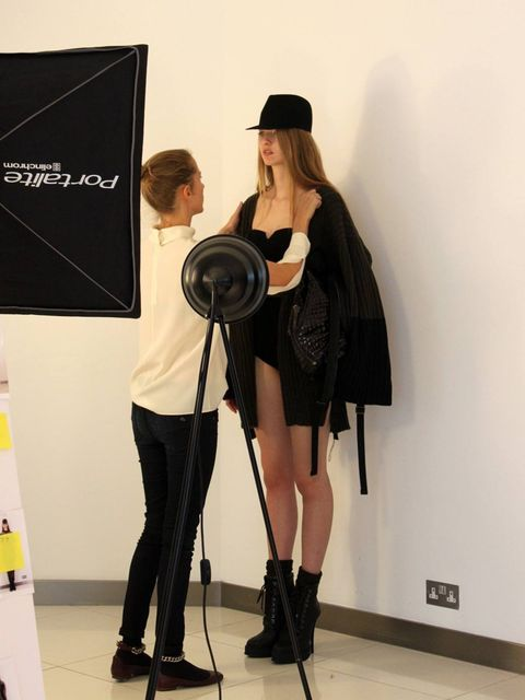 <p>A model is shot wearing a look from the aw12 collection</p>