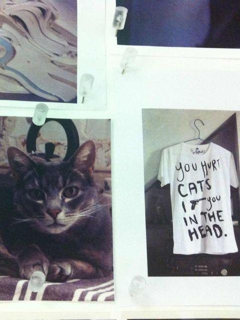<p>Polaroids on the pin board in Topshop Unique studio</p>