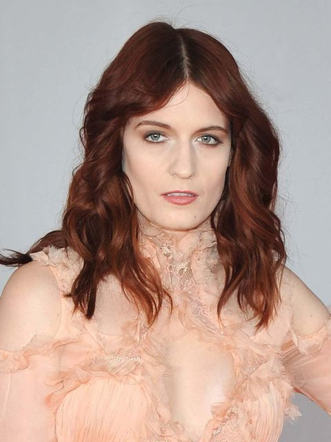 <p>Florence Welch at the Brit Awards 2012 with darker hair.</p>