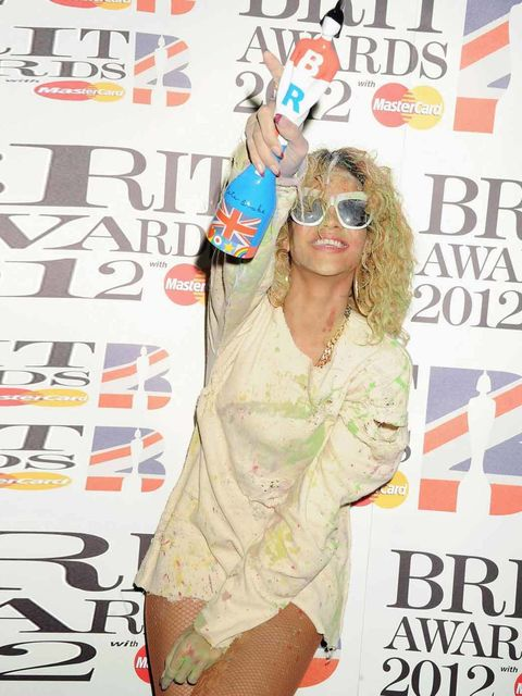 """<p><a href=""""http://www.elleuk.com/star-style/celebrity-style-files/rihanna"""">Rihanna</a> clutches her award for International Female Solo Artist at the Brit Awards 2012</p>"""