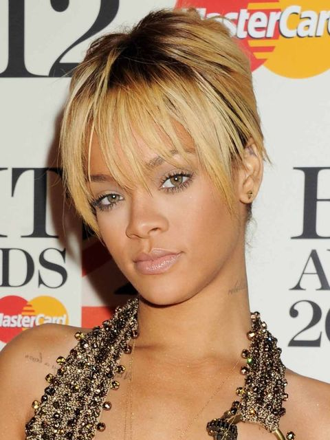 <p>Rihanna wears her hair in a simple chignon. </p>