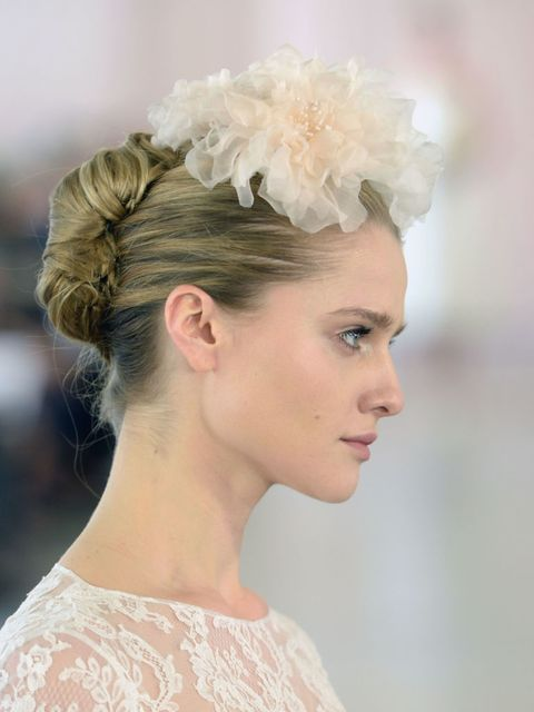 Oscar De La Renta brought back the French twist and made it modern with an exaggerated tulle fascinator