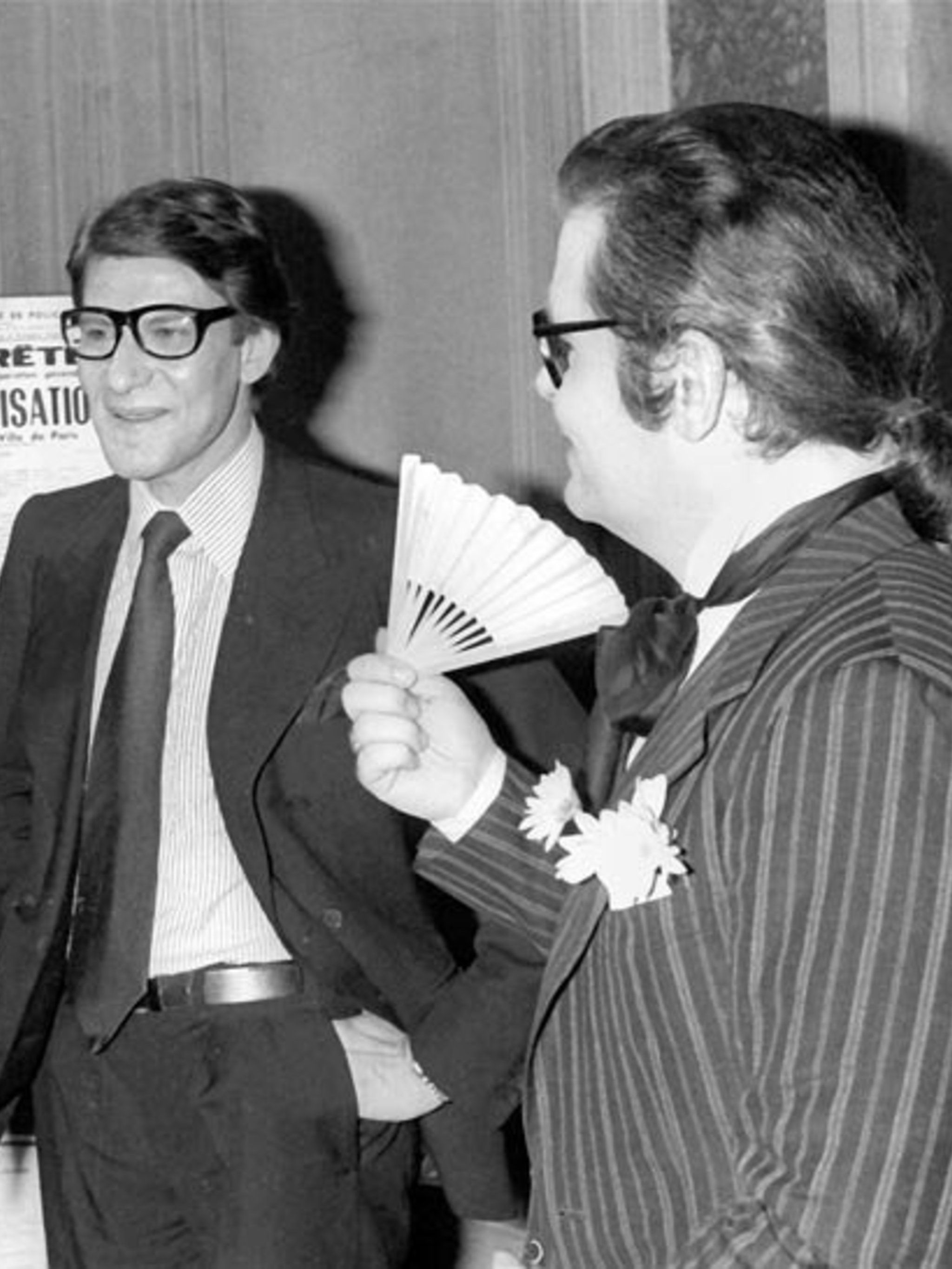 <p>An early-career photograph of Yves Saint Laurent and Karl Lagerfeld</p>