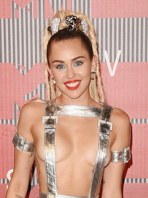 <p>Miley Cyrus was inspired by Chanel's Autumn/Winter 2014 show, adding a dreadlock ponytail to her usual crop.</p>