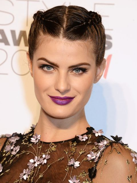 Isabeli Fontana goes edgy with braids and purple lipstick - we salute you.