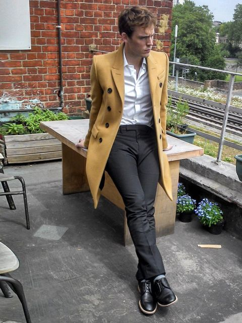 """<p>Sam Claflin smoulders in Burberry Prorsum on the balcony for his ELLE November Issue shoot</p><p><a href=""""http://www.elleuk.com/elle-tv/red-carpet/parties-events/sam-claflin-november-2013-issue-behind-the-scenes-photo-shoot-video"""">See our exclusive beh"""