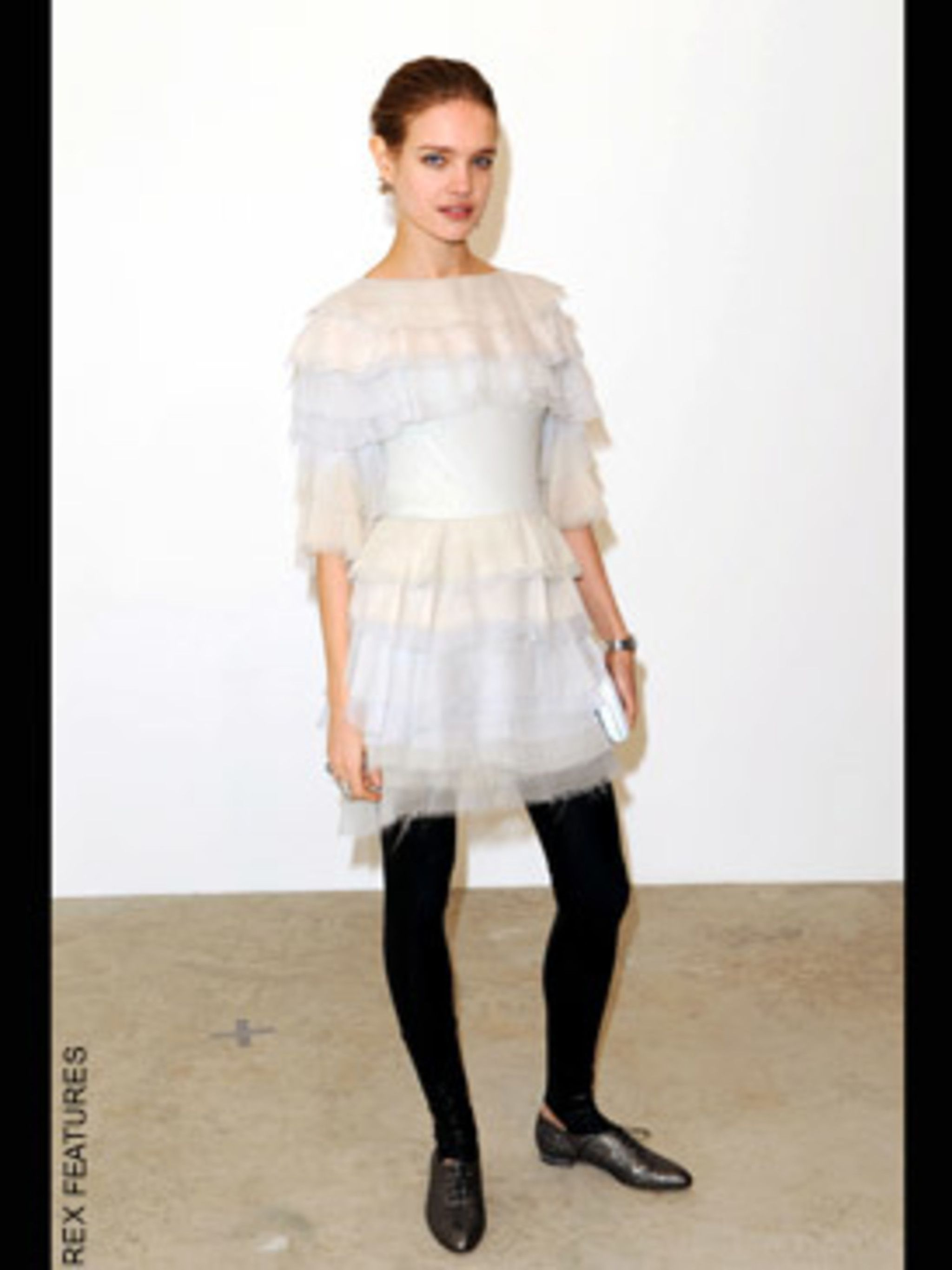 <p>In Chanel frill's and stirrup leggings at Chanel's Maison d'Art show in London</p>