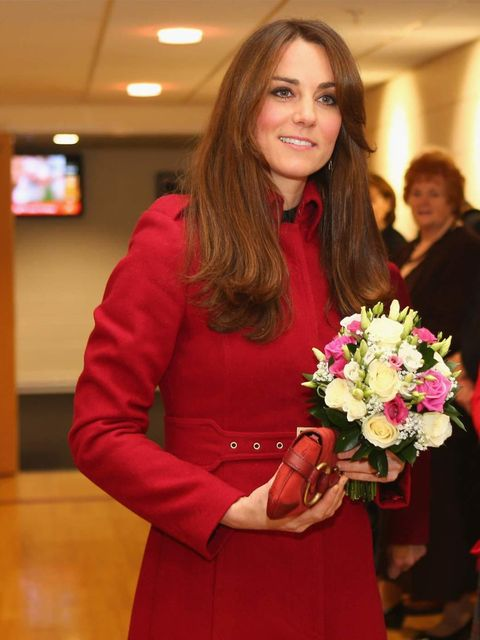 "<p><a href=""http://www.elleuk.com/star-style/celebrity-style-files/kate-middleton"">Kate Middleton</a> wears a red LK Bennett coat with a matching <a href=""http://www.elleuk.com/catwalk/designer-a-z/gucci/spring-summer-2013"">Gucci</a> 1921 collection clutc"