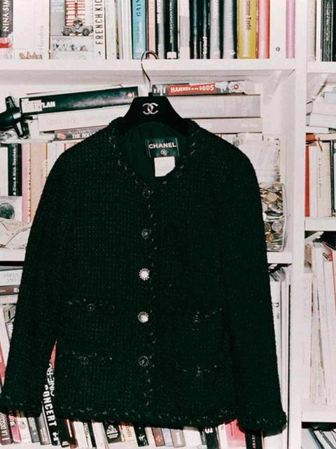 <p>Her essential black Chanel jacket</p>