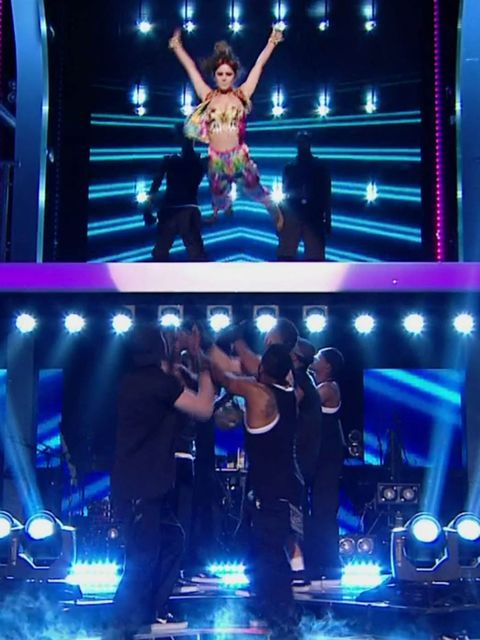 <p>Cheryl Cole dives off a balcony during her performance on The Voice</p>