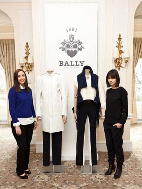 <p>Central Saint Martins students Alice Bastin and Mei Lim Cooper pose with their designs</p>