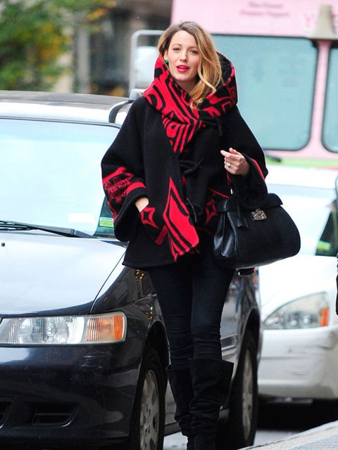 <p>An unstructured cape is just the thing for growing bumps.</p>  <p>Blake Lively wears Lindsey Thornburg in New York, November 2014.</p>