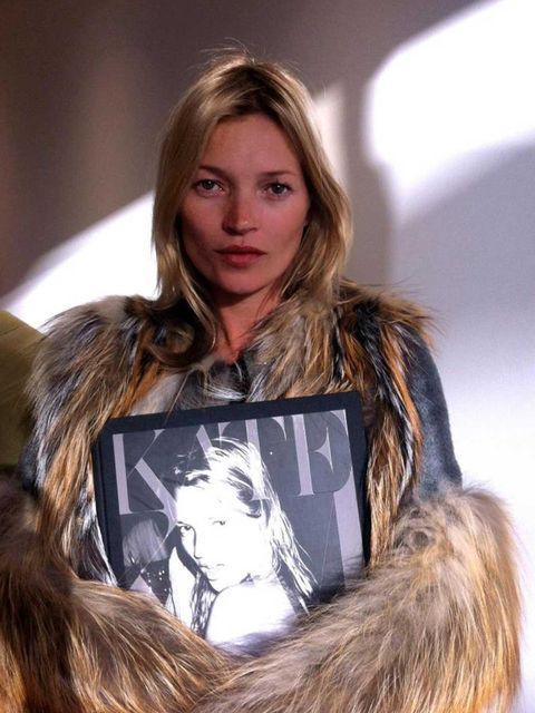 <p>Kate Moss with her book - Kate: The Kate Moss Book</p>