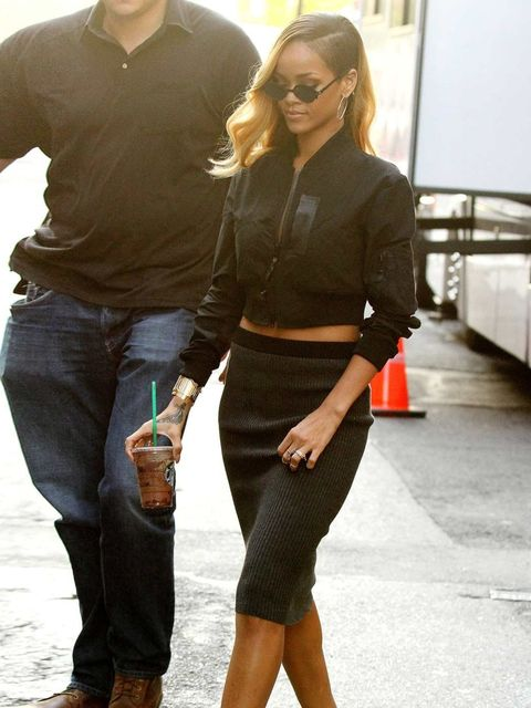 """<p><a href=""""http://www.elleuk.com/star-style/celebrity-style-files/rihanna"""">Rihanna</a> arrives at the filming of a commercial in New York, wearing a cropped black bomber jacket with grey pencil skirt.</p><p><em>More celebrity fashion trends:</em></p><p><"""