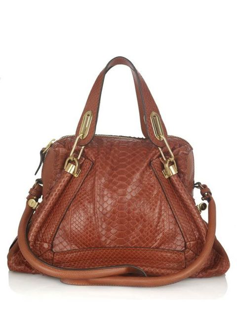 "<p>Satisfyingly large and maleable enough to take all manner of fashion week appendage; odd shaped invitations, notebook, camera, blackberry, 5 pens, none of which I'll find... </p><p>Python shoulder bag, £1,895, by Chloe at <a href=""http://www.net-a-port"