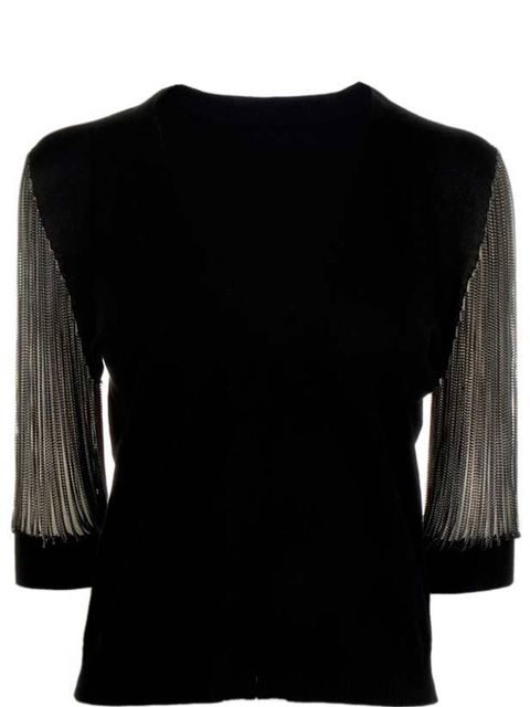 <p>Black jumper with chains, £59, by COS (0207 478 0400)</p>