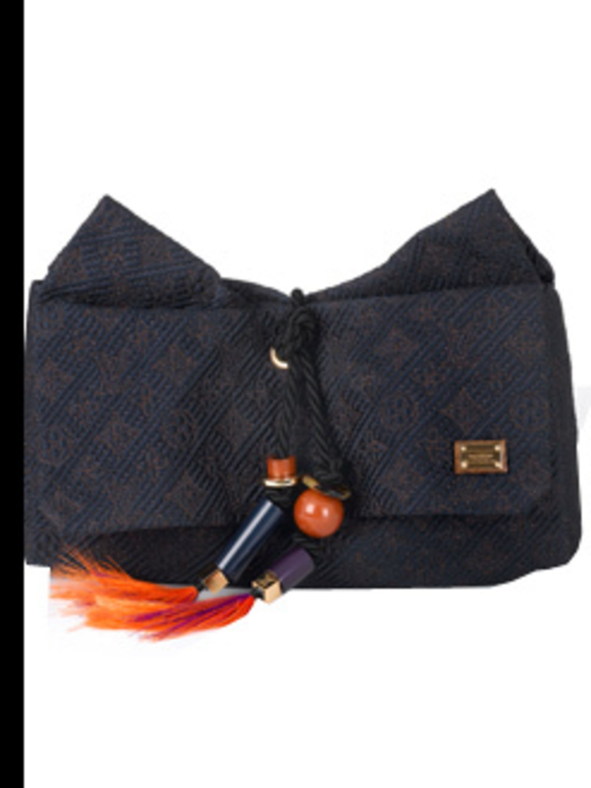 <p>Clutch, £1,790.00 by Louis Vuitton. For stockists call 0207 399 4050. 'If I can't pack enough to change my whole outfit every day then I'll change my handbags instead. The pattern and colour on this clutch are just enough to add colour to the sea of bl