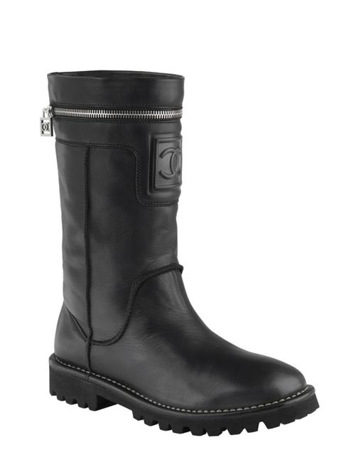 <p>Leather biker boots, £630, by Chanel (0207 493 5040)</p>