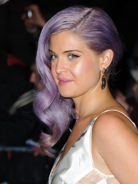 <p>Kelly Osbourne has been sporting various tones of lilac in her hair for a while. This hue with the grey undertone suits the presenter's skintone perfectly. Kelly calls on make-up artist and hairstylist Judd Minter to keep her tresses just the right lav