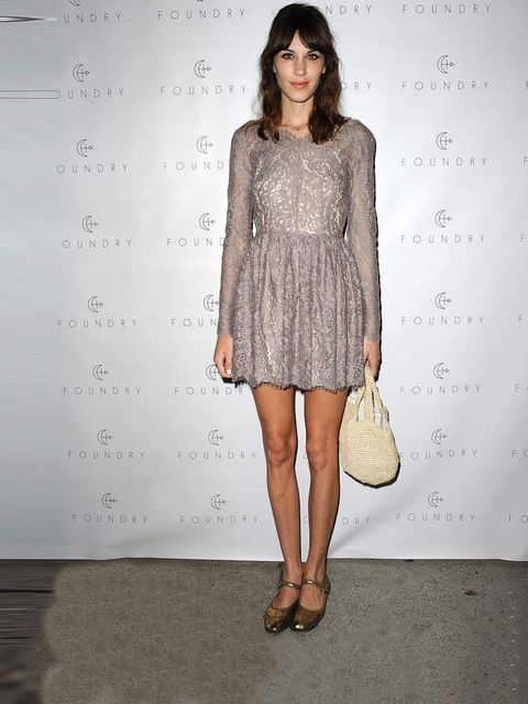 <p>Alexa Chung matched a pair of gold metallic flats with a dress designed by Lover at the Foundry store launch in LA.</p>