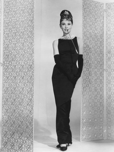 <p>Audrey Hepburn wears a Givenchy designed long black sleeveless cocktail dress in Breakfast At Tiffany's.</p>