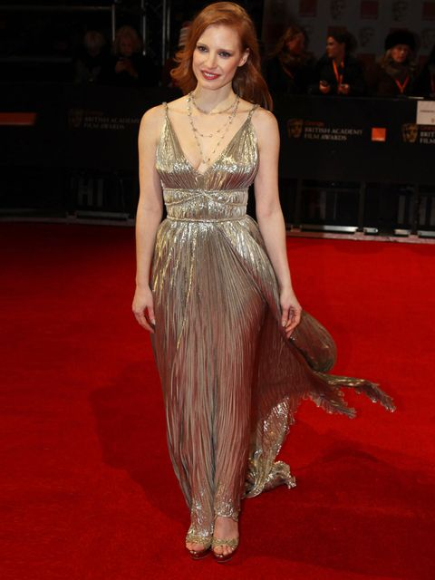 "<p>Jessica Chastain wore a gold <a href=""http://www.elleuk.com/catwalk/designer-a-z/oscar-de-la-renta/spring-summer-2012"">Oscar de la Renta</a> gown to the 2012 BAFTA Awards.</p>"